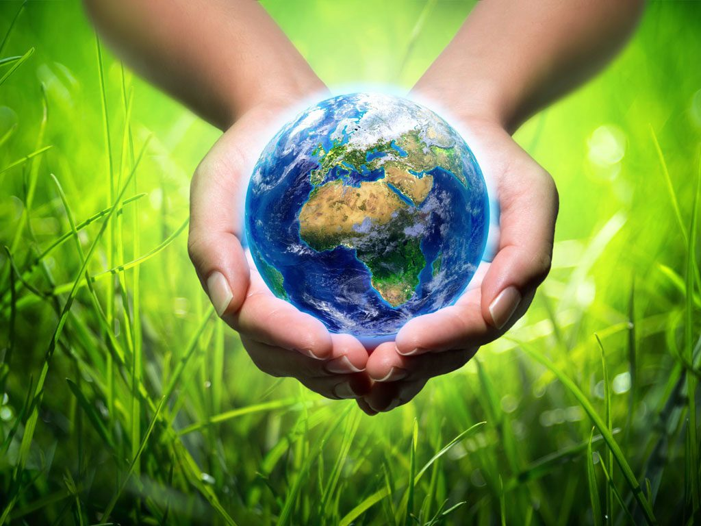 We care about the environment- hands holding the world