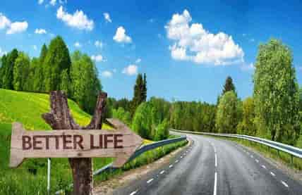 Easy and enjoyable money course for young adults-landscape of road and better life sign
